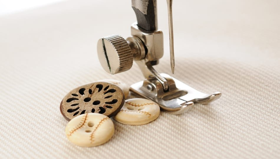 dreamstime_xl_26988290 950 x 540 Can Sewing Machines Sew Buttons