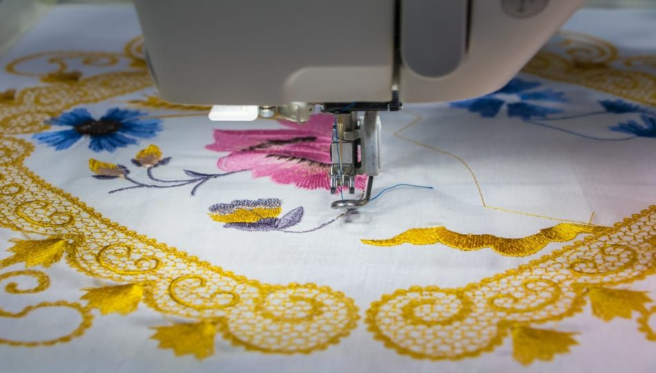 iStock-636715722 950 x 540 Can a Sewing Machine Embroider Machine Versus Hand Stitches