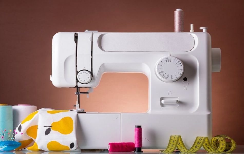 Household sewing machine, accessories, fabric under presser foot. Working process